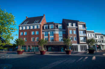Apartment complex and shops in Best